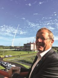ESA Director General Jan Woerner at the Guiana Space Center in Kourou, French Guiana, on July 25 as an Ariane 5 lifts off in the background with four Galileo navigation satellites onboard. Credit: ESA via Twitter
