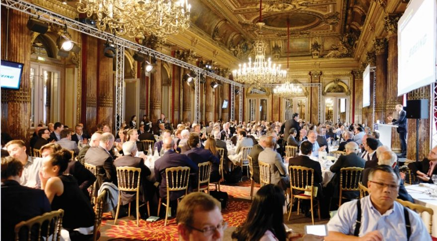 Euroconsult CEO Pacôme Révillon welcomes Boeing Satellite Systems President Chris Johnson to the stage during one of the lavish lunches World Satellite Business Week holds in the Imperial Ballroom at the Westin Paris-Vendôme hotel. Credit: Brian Berger