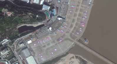 Orbital Insight relies on computer vision and machine learning to derive information from balloon, drone and satellite imagery. Orbital Insight identified aircraft in this DigitalGlobe image. Credit: DigitalGlobe