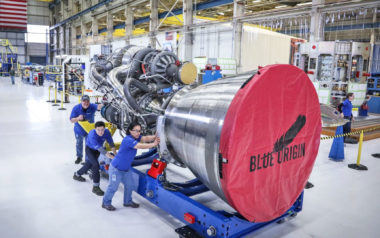 Blue Origin employees move an assembled BE-4 engine at the company's Seattle rocket and spacecraft factory. Credit: Blue Origin