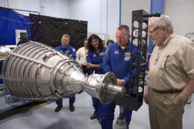 NASA astronauts get acquainted with an RL10 engine during a tour of Aerojet Rocketdyne's facility in West Palm Beach, Florida. Credit: NASA