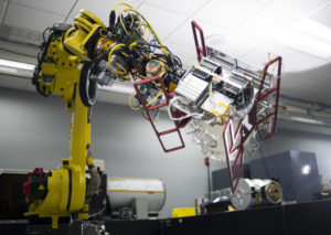 Robotic arm moving small satellite