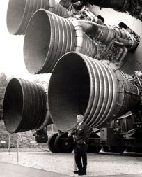 Wernher von Braun standing in front of F-1 engines mounted on a Saturn 5 test vehicle on display at the U.S. Space & Rocket Center in Huntsville, Alabama. Credit: NASA