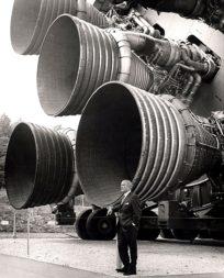 Wernher von Braun standing in front of F-1 engines mounted on a Saturn 5 test vehicle on display at the U.S. Space & Rocket Center in Huntsville, Alabama. Credit: NASA