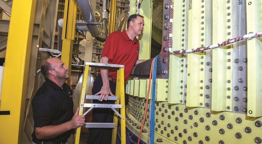 NASA Administrator Jim Bridenstine looks inside the test version of the SLS intertank during an Aug. 15 visit to Marshall Space Flight Center in Huntsville, Alabama.