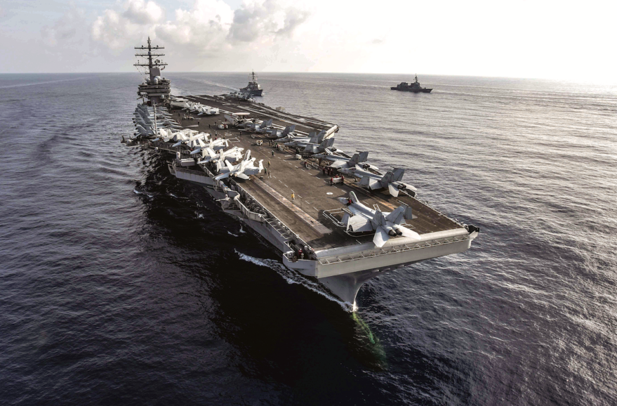 Aircraft carrier USS Ronald Reagan and the guided-missile destroyer USS Milius in the South China Sea in August. The Pentagon worries that adversaries are developing a new class of hypersonic missiles that could be targeted at U.S. and allied forces, and is looking to add a new layer of space sensors to detect these threats. Credit: U.S. Navy.