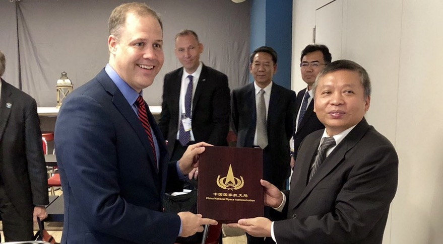 https://spacenews.com/wp-content/uploads/2018/10/bridenstine-zhang.jpg