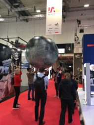 An inflatable moon bounces through an exhibit hall at the International Astronautical Congress in Bremen, Germany. Credit: Jeff Foust/SpaceNews