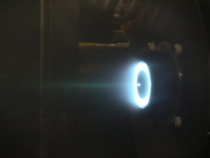 This image shows the test firing of ExoTerra Resources' xenon fueled microsatellite thruster.  Credit: ExoTerra Resources