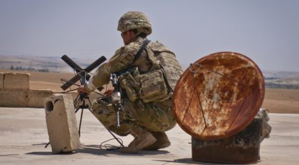 A U.S. soldier sets up an antenna in order to transmit a situational report to his higher command during a patrol with Turkish military forces along the demarcation line outside Manbij, Syria, in July.  Credit: U.S. Army photo by Staff Sgt. Timothy R. Koster