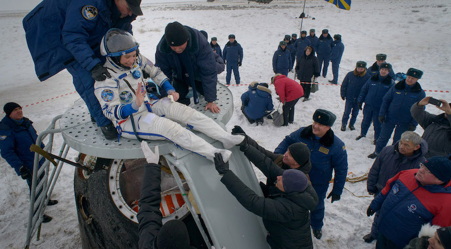 NASA astronaut Serena Auñón-Chancellor is helped out of the Soyuz MS-09 spacecraft just minutes after she, ESA astronaut Alexander Gerst and Roscosmos cosmonaut Sergey Prokopyev landed Dec. 20 in a remote area near the town of Zhezkazgan, Kazakhstan (Credit: NASA/Bill Ingalls)