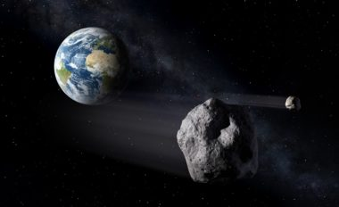 An asteroid passes by Earth in this NASA illustration. Credit: NASA