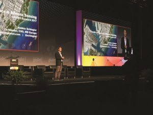 """The real opportunity is to deliver insight in a way that helps anyone make a better decision,"" said Robbie Schingler, Planet co-founder and chief strategy officer, shown above speaking at GEOINT 2017 in San Antonio, Texas. ""That's when we will evolve this smaller industry, which is about a $5 billion addressable market, to be part of the business-to-business information services economy, a $100 billion, $200 billion industry. That's what we're focused on."" Credit: @GEOINTSYMPOSIUM via Twitter"