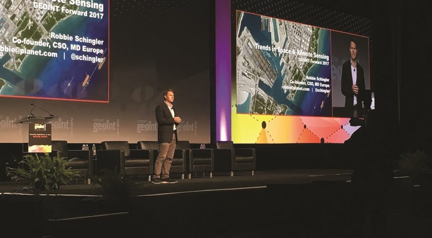 """""""The real opportunity is to deliver insight in a way that helps anyone make a better decision,"""" said Robbie Schingler, Planet co-founder and chief strategy officer, shown above speaking at GEOINT 2017 in San Antonio, Texas. """"That's when we will evolve this smaller industry, which is about a $5 billion addressable market, to be part of the business-to-business information services economy, a $100 billion, $200 billion industry. That's what we're focused on."""" Credit: @GEOINTSYMPOSIUM via Twitter"""