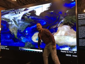 Gary Partyka, who works at the NASA Goddard Space Flight Center under a contract with Science Systems and Applications Inc., shows a 2017 simulation of hurricanes and aerosols at the 2019 American Meteorological Society conference in Phoenix. Credit: SpaceNews/Debra Werner