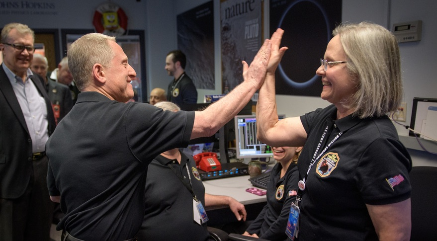 Alan Stern, the principal investigator for New Horizons, high-fives Alice Bowman, mission operations manager, after controllers received a transmission from the spacecraft Jan. 1 confirming the success of the flyby. Credit: NASA/Bill Ingalls