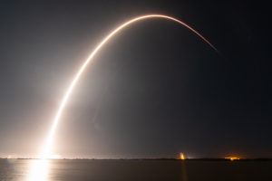 A Falcon 9 lifted off Feb. 21 with a 4,100-kilogram communications satellite, a 600-kilogram lunar lander and a 60-kilogram experimental smallsat. Credit: Jordan Sirokie for SpaceNews.