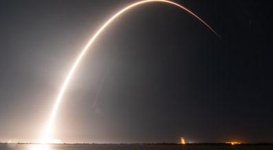 A Falcon 9 lifted off Feb. 21 with a 4,100-kilogram communications satellite, a 600-kilogram lunar lander and a 60-kilogram experimental smallsat. Credit: Jordan Sirokie for SpaceNews.