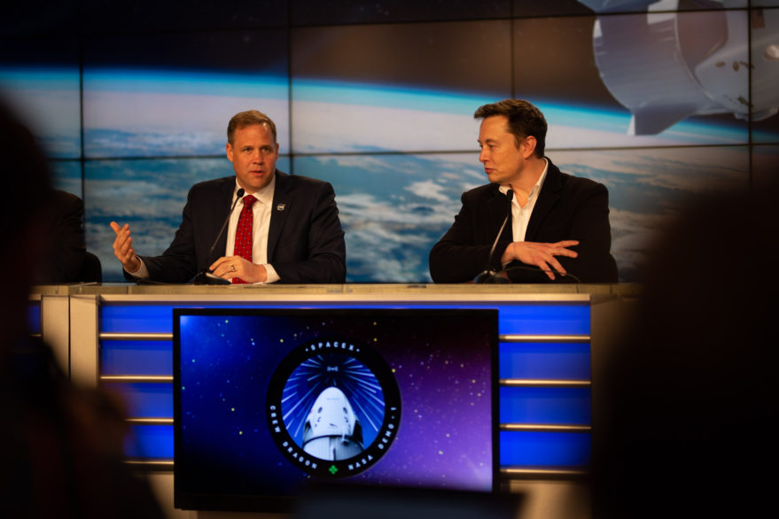NASA Administrator Jim Bridenstine, left, and Elon Musk address reporters at a DM-1 news conference at KSC. Credit: Craig Vander Galien for SpaceNews