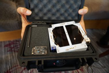 Measuring just 2.8 centimeters thick, Swarm's SpaceBee satellites can be carried in a small case. Credit: SpaceNews/Caleb Henry