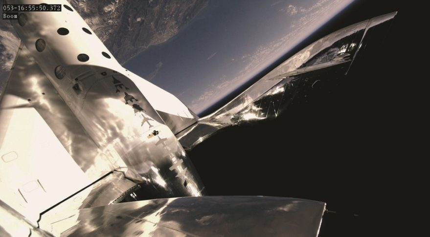 SpaceShipTwo, with its tail booms raised in the feathered position, near the 89.9-kilometer peak altitude the vehicle achieved during its Feb. 25 suborbital spaceflight. Credit: Virgin Galactic