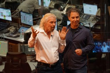 Sir Richard Branson, left, with OneWeb founder Greg Wyler at the Guiana Space Centre in French Guiana for OneWeb's Feb. 27 inaugural launch. Credit: SpaceNews/Caleb Henry