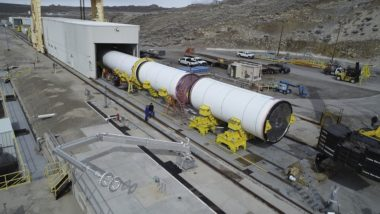 The two solid rocket motors comprising the first stage of OmegA recently arrived at Northrop Grumman's test stand in Promontory, Utah. Technicians are attaching instrumentation gauges and data recorders in preparation for the full-scale static test will qualify the OmegA first stage for spaceflight. Credit: Northrop Grumman Innovation Systems