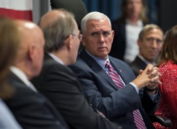 Vice President Mike Pence turns to talk to Scott Pace, National Space Council executive secretary. Credit: NASA/Bill Ingalls