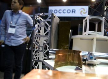 Roccor hardware on display at the Small Satellite Conference in 2018. The Colorado firm is contributing a deployable antenna for a SpEC project led by another company. Credit: SpaceNews