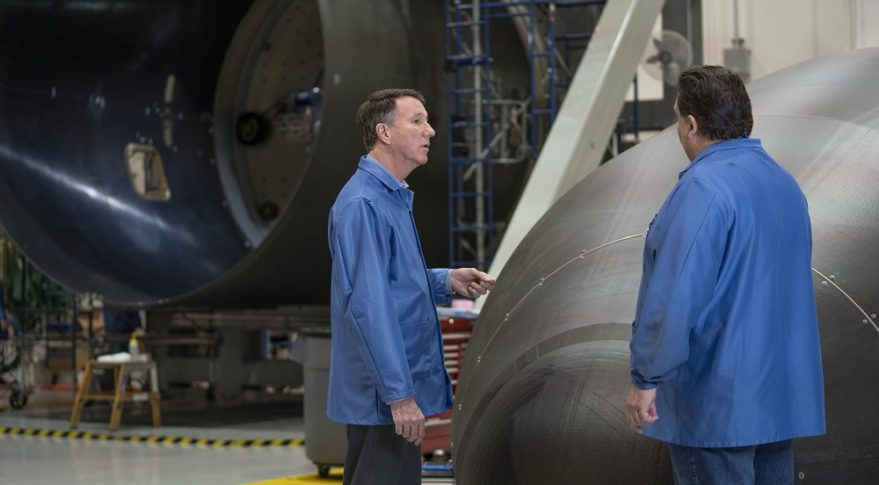 Kent Rominger, vice president of Northrop Grumman strategic programs, left, studies an Antares composite fairing like those Northrop Grumman will manufacture for OmegA at the company's Iuka, Mississippi, facility. Credit: Northrop Grumman Innovation Systems