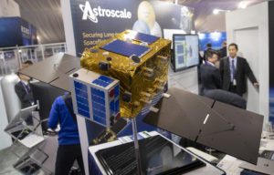 Scale model of Astroscale's Space Debris Removal Satellite ELSA-d on display at the 35th Space Symposium at the Broadmoor Hotel in Colorado Springs, Colorado, April 10, 2019. (Keith Johnson/SpaceNews)