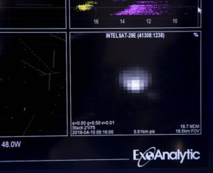 Exoanalytic Solutions' depiction the Intelsat-29e anomaly was on display at the 35th Space Symposium at the Broadmoor Hotel in Colorado Springs, Colorado, April 10. (Keith Johnson/SpaceNews)