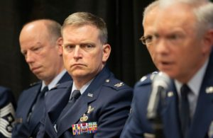 Air Force Col. Robert Bongiovi, director of the Launch Systems Enterprise Directorate, second from left, speaks with reporters April 11, 2019, at the 35th Space Symposium.  Credit: Keith Johnson