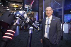 Dan Jablonsky, president and CEO of MAXAR, shown here with a Maxar Space Solutions robotic arm at the 35th Space Symposium at the Broadmoor Hotel in Colorado Springs, CO, April 9, 2019. (Keith Johnson/SpaceNews)