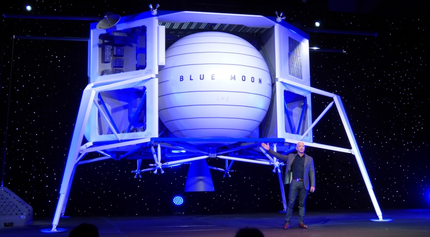 9eb9c8ba91636 Jeff Bezos stands in front of a full-sized model of Blue Origin s Blue Moon  lander May 9 in Washington. Credit  SpaceNews Jeff Foust