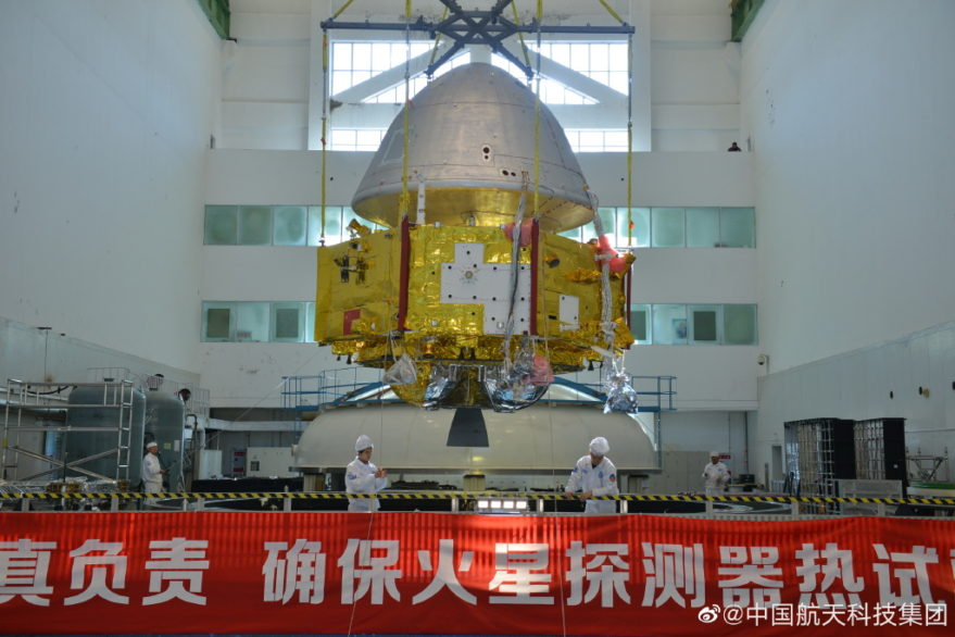 Chinese Mars spacecraft being lowered into a thermal-vacuum test chamber.