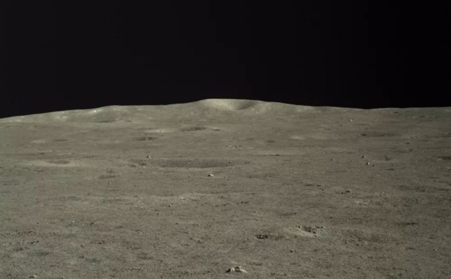 An image taken by the Chang'e-4 mission rover Yutu-2 showing the central peak of Von Kármán crater on the far side of the moon, around 46 kilometers distant from the rover.