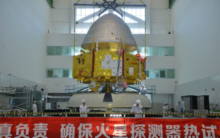 Image of China's Mars 2020 orbiter and heat shield for the landing segment undergoing space environment testing.