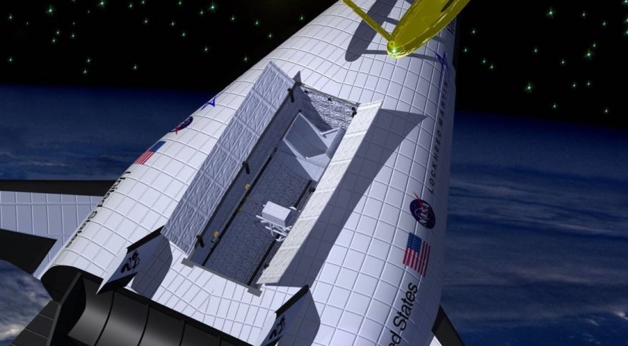 artist's concept of X-33 reusable launch vehicle deploying a satellite.