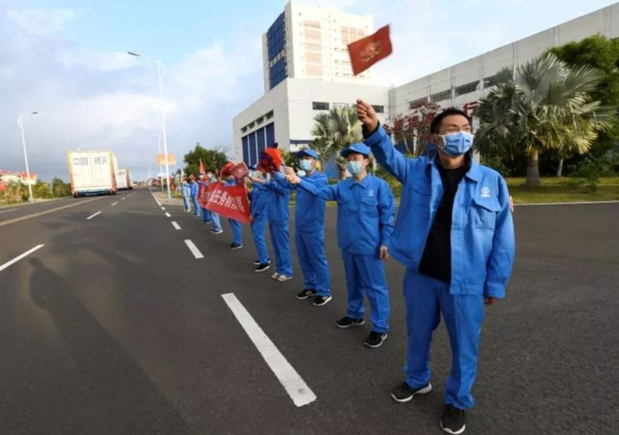 Masked workers welcome the Long March 5B components to Wenchang Satellite Launch Center.