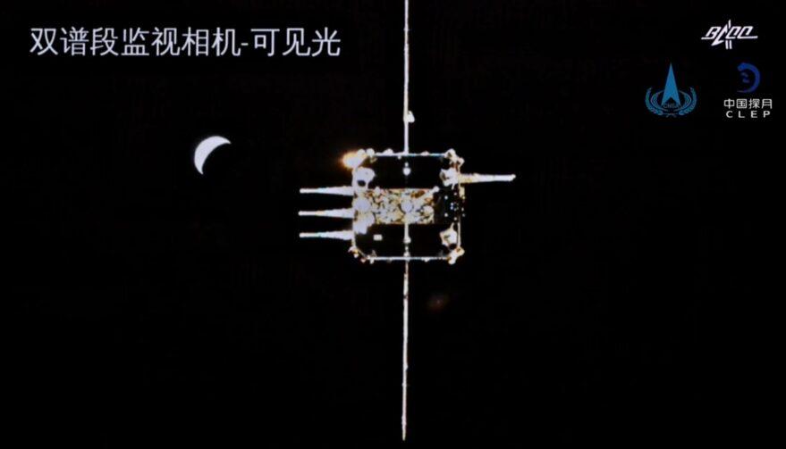 The Chang'e-5 landing craft approaches the orbiter in lunar orbit.
