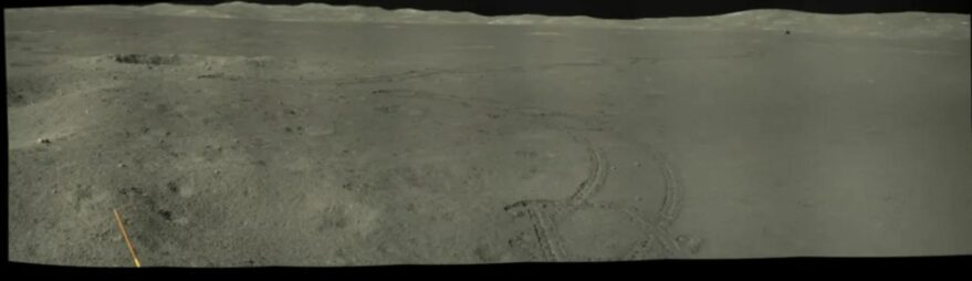 A view of Von Kármán crater showing the distant  Chang'e-4 lander, roving tracks and crater rim in December 2020.