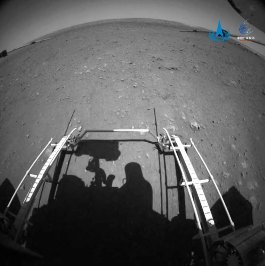 A forward hazard avoidance camera view during Zhurong rover deployment onto Mars.