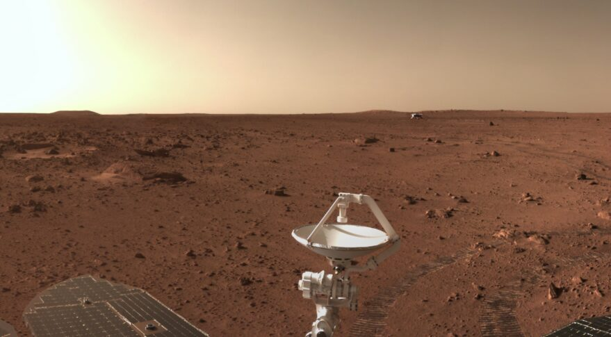 A section of a panorama produced by Zhurong, released June 27, showing comms and solar arrays, roving tracks and the distant landing platform.