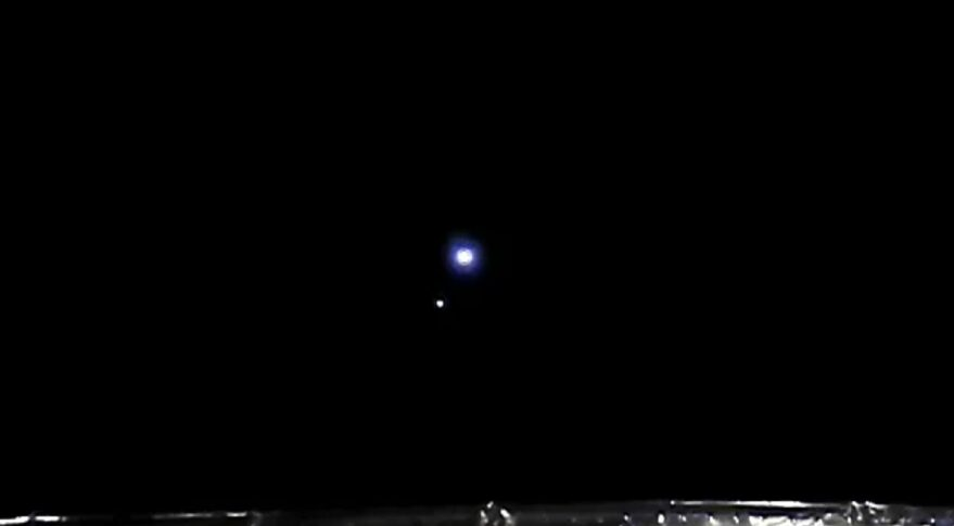 The Earth and moon viewed by Chang'e 5 from Sun-Earth Lagrange point 1 in April 2021.