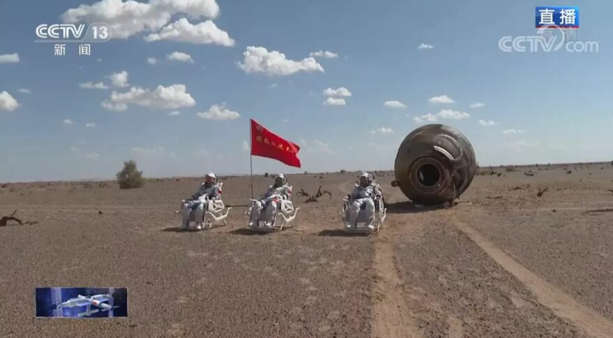 The three Shenzhou-12 astronauts outside of the return module after landing in Dongfeng, Sept. 17, 2021.